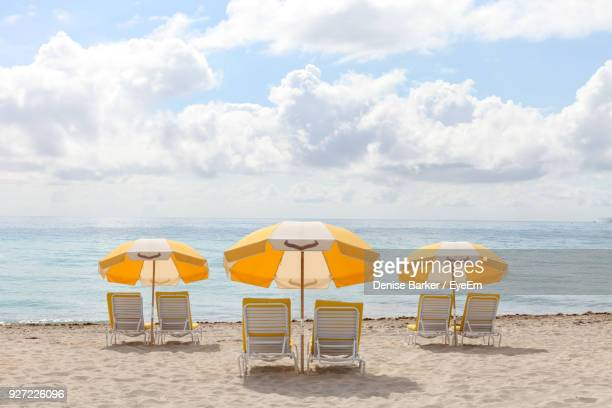 deck chairs at beach against sky - miami beach stock pictures, royalty-free photos & images