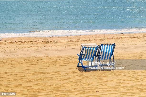 deck chairs at beach - massimiliano ranauro stock pictures, royalty-free photos & images