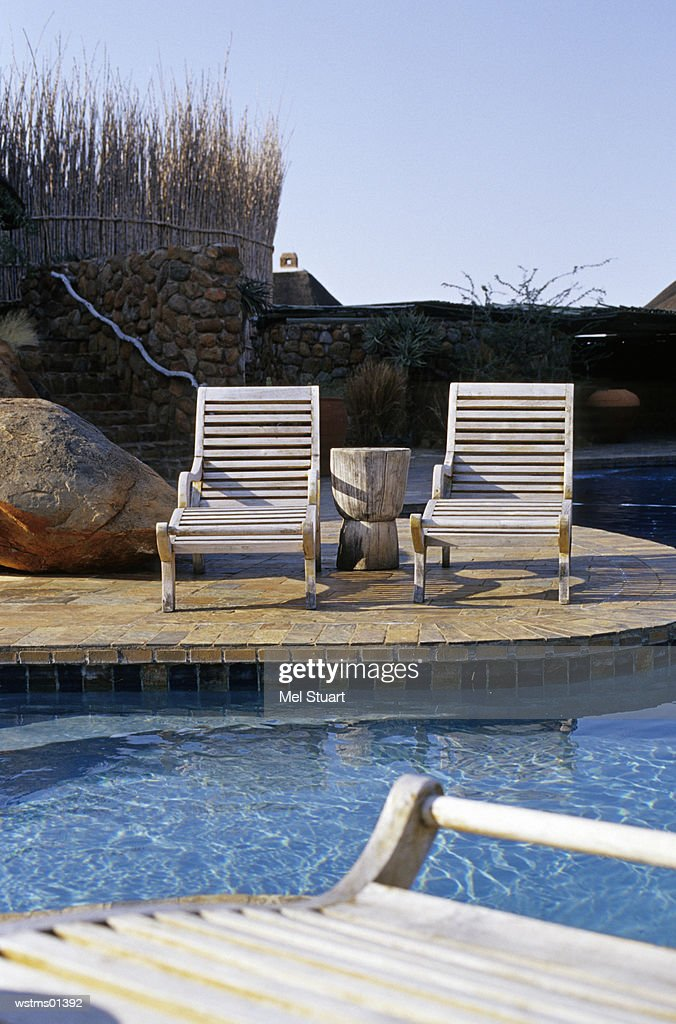 Deck chairs by poolside, South Africa : Foto de stock