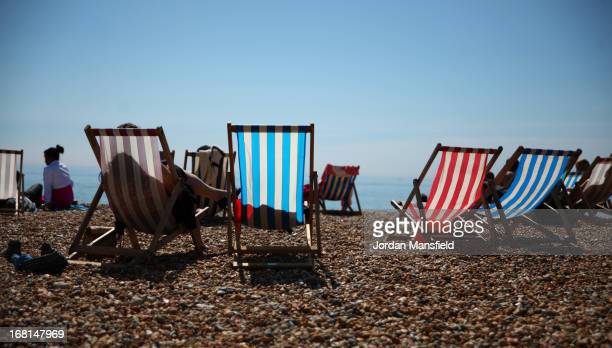 Deck chairs in the sun on Brighton Beach on May 6 2013 in Brighton England Visitors have flocked to Brighton Beach as the Met Office predict the May...