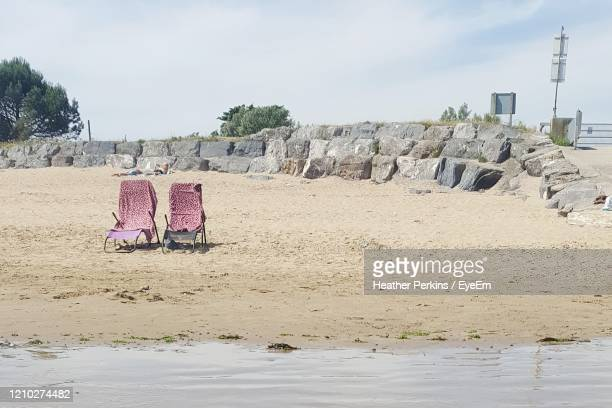 deck chairs on a british beach - porthcawl stock pictures, royalty-free photos & images