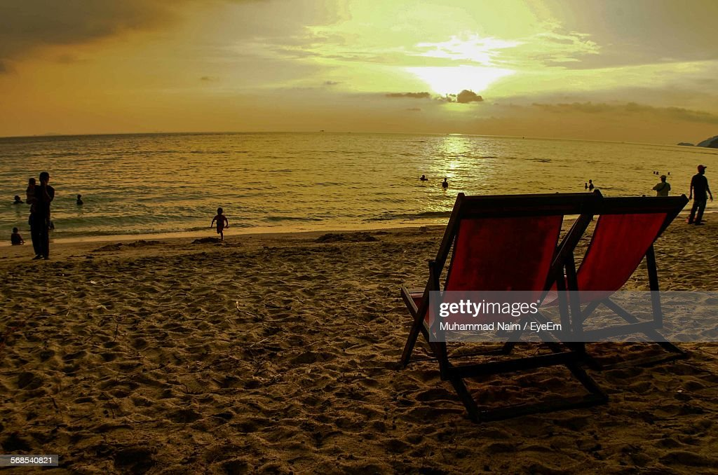 Deck Chairs On Beach During Sunset : Stock Photo
