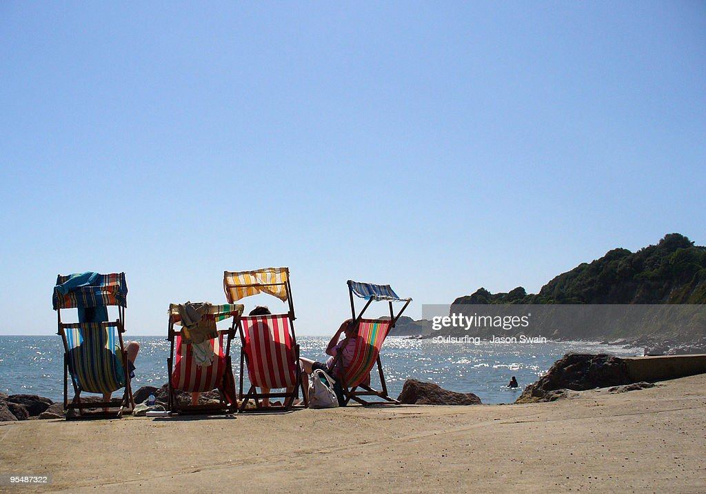 Deck chairs on beach : Stock Photo
