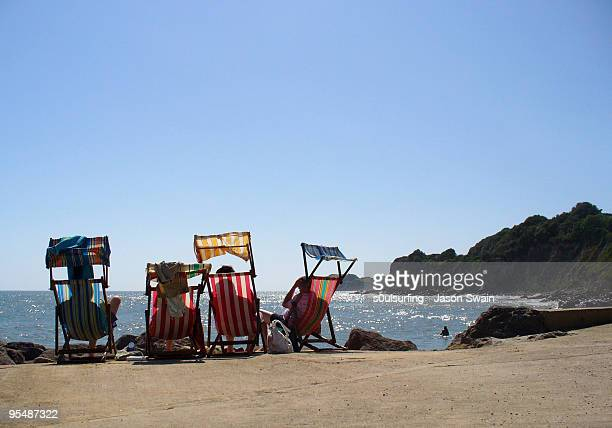 deck chairs on beach - s0ulsurfing stock pictures, royalty-free photos & images