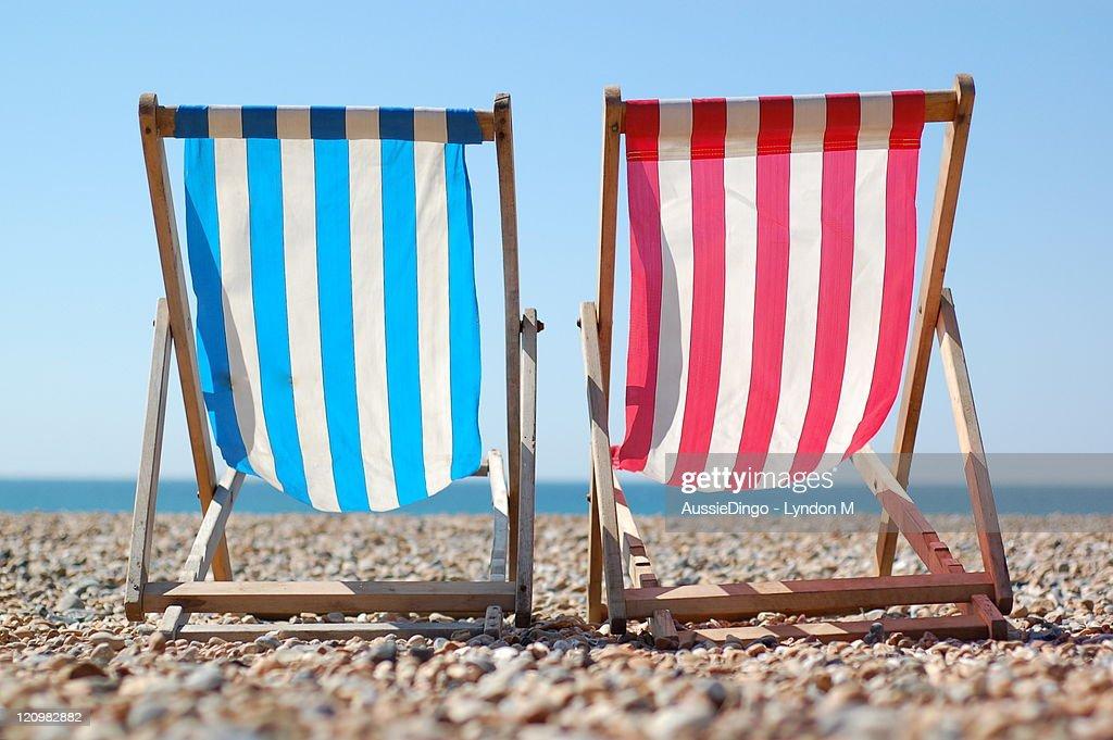 Deck chairs on Brighton beach, English Seaside : Stock Photo