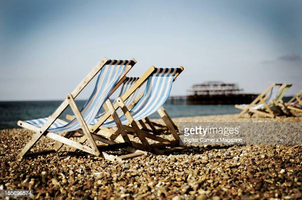 Deck chairs on Brighton beach, with the derelict West Pier visible in the distance, taken on August 24, 2011.