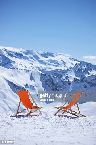 deck chairs standing in front of view - courchevel stock pictures, royalty-free photos & images