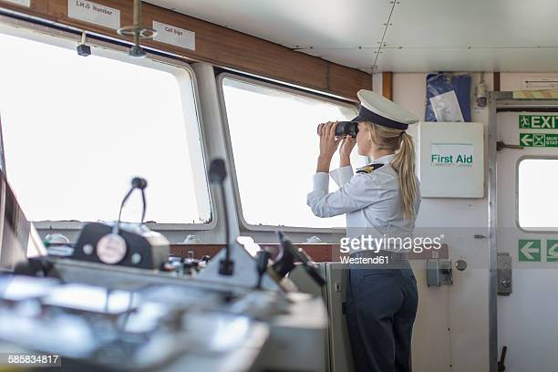 deck officer on ship looking through binoculars - sailor hat stock pictures, royalty-free photos & images