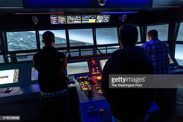 Deck Officer students Aaron Golczynski [cq] a ship captain from Burney Calif left Blake Armand Third Mate from Ketchum Idaho second left at helm and...