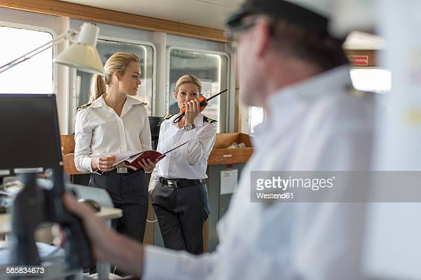 deck officers and ship captain on bridge - besatzung stock-fotos und bilder