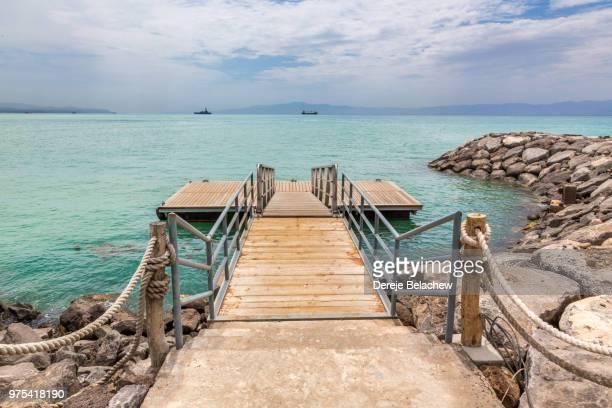 deck on red sea shore - djibouti stockfoto's en -beelden