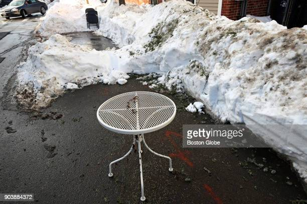 A deck table serves as a 'space saver' for a parking spot in East Sixth Street in South Boston on Jan 9 2018 Boston has enforced a 48hour rule when...