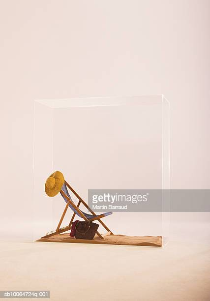 Deckchair and hat in glass cabinet