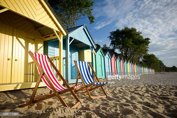 deckchair beach scene - coastline stock photos and pictures