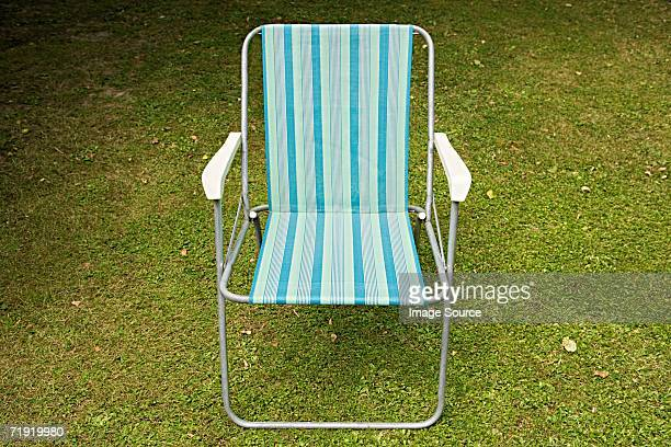 deckchair on a lawn - outdoor chair stock pictures, royalty-free photos & images