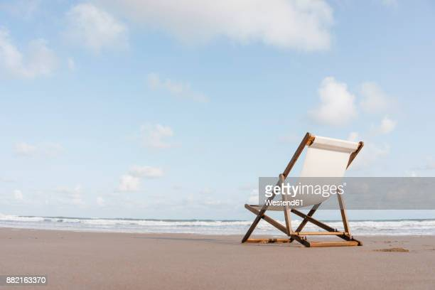 deckchair on the beach - outdoor chair stock pictures, royalty-free photos & images