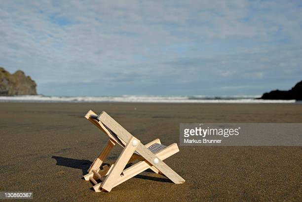Deckchair on the Pihabeach, New Zealand, symbolic picture for holidays