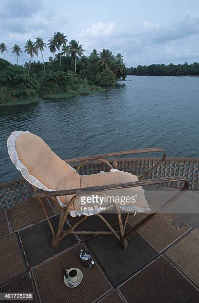 A deckchair on the roof of a houseboat gliding through Kerala's myriad of backwaters or natural canals that meander along India's southern coastline...