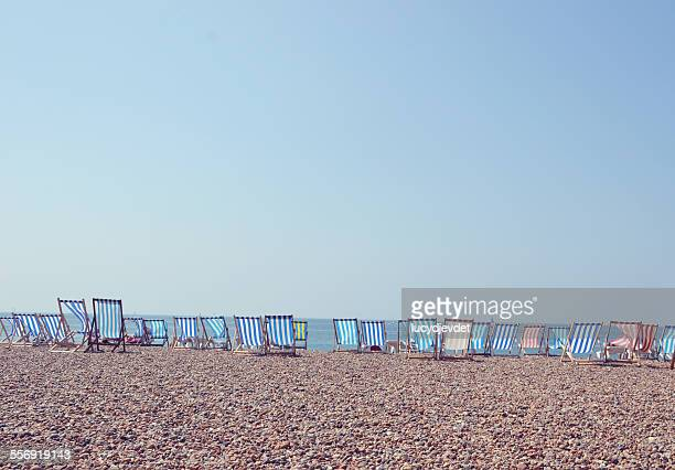 Deckchairs in a row on Brighton Beach, UK