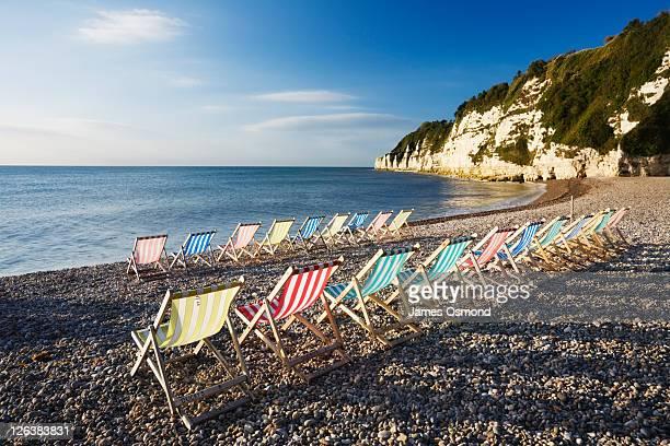 deckchairs on beer beach, devon, england, uk - デヴォン州 ストックフォトと画像