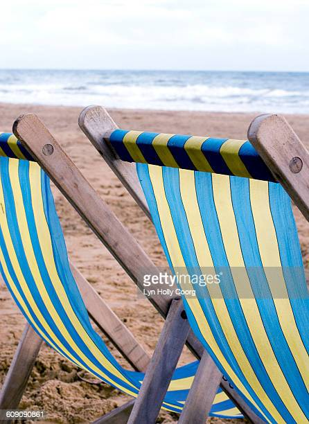 deckchairs on sandy beach - lyn holly coorg stock pictures, royalty-free photos & images