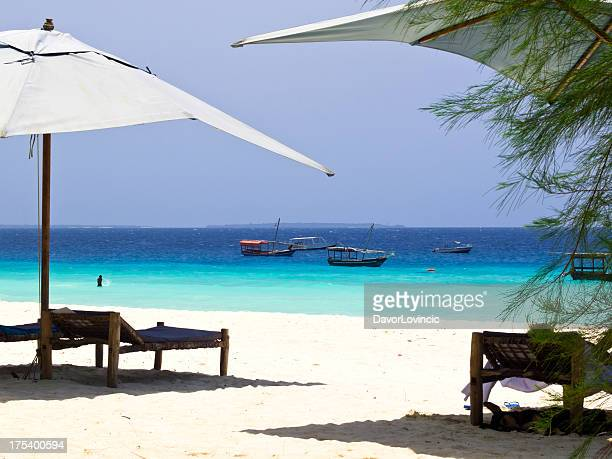 deckchairs - zanzibar island stock photos and pictures