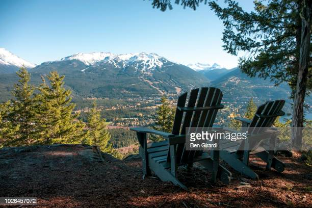 deckchairs with view of mountains, whistler, british columbia, canada - whistler british columbia stock pictures, royalty-free photos & images
