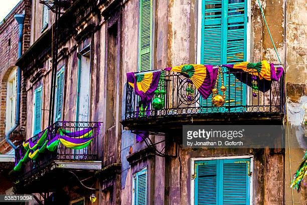 decked out for mardi gras - new orleans french quarter stock photos and pictures