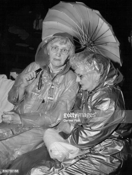 Decked out in rainwear like many others were Mrs Melba Bennett of 14775 W 6th Ave Golden and Mrs Inger Gramps of 130 E 9th Ave Credit Denver Post