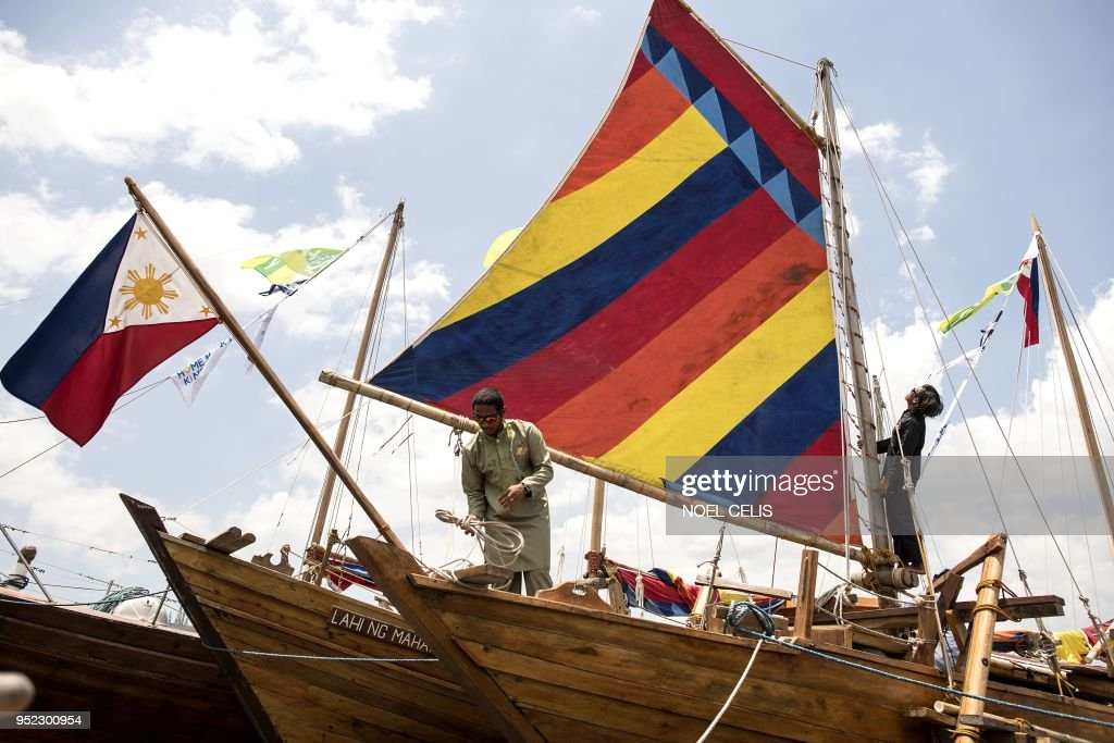 A deckhand works on board a traditional Philippine wooden boat known as 'balangay' before setting sail from Manila to China on April 28, 2018. - Three identical wooden boats crafted from a centuries-old design set off from the Philippine capital for China on April 28 to retrace a historic trip by a Filipino sultan and showcase longstanding maritime ties.