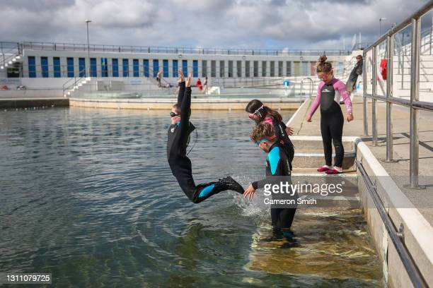 Declan and other jump into the pool on April 06, 2021 in Penzance, England. Jubilee Pool is a community run pool housed in a Grade 2 listed art-deco...