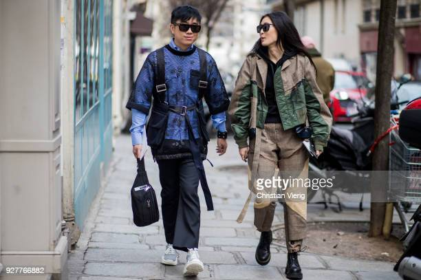 Declan Chan and Justine Lee is seen outside Sacai during Paris Fashion Week Womenswear Fall/Winter 2018/2019 on March 5 2018 in Paris France