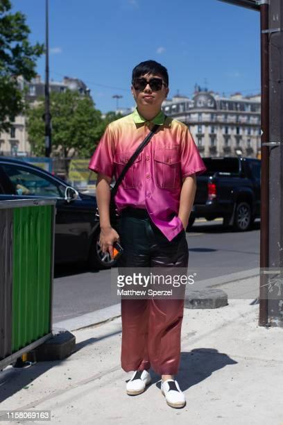 Declan Chan is seen on the street during men's Paris Fashion Week wearing pink/orange rainbow shirt, accordion bag on June 22, 2019 in Paris, France.