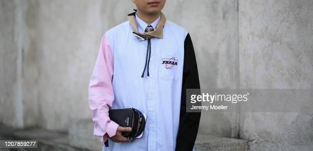 Declan Chan is seen wearing a full Prada look during Milan Fashion Week Fall/Winter 2020-2021 on February 20, 2020 in Milan, Italy.