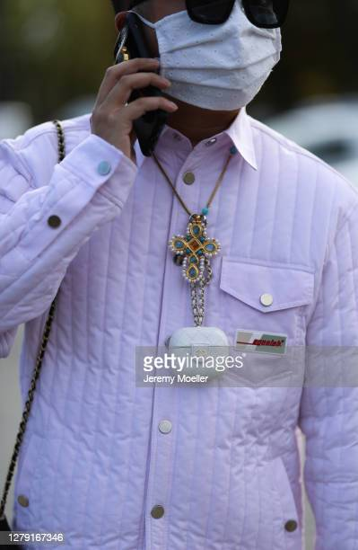 Declan Chan seen wearing a Chanel chain and Egonlab jacket outside Chanel during Paris Fashion Week - Womenswear Spring Summer 2021 : Day Nine on...