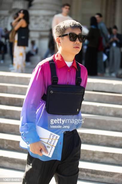 Declan Chan wears a Alyx chest rig bag Sies Marjan pink/blue gradient shirt during Paris Fashion Week Spring/Summer 2019 on September 27 2018 in...