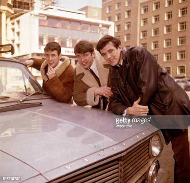 Declan Cluskey, Conleth Cluskey and John Stokes of Irish vocal group The Bachelors pictured beside a Vauxhall car in London in 1964.