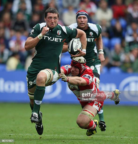 Declan Danaher of London Irish races away from Alasdair Strokosch during the Guinness Premiership match between London Irish and Gloucester at the...