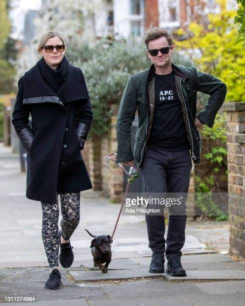 Declan Donnelly and Ali Astall seen taking their dog for a walk after it was reported that burglars attempted but failed to force open iron gates at...