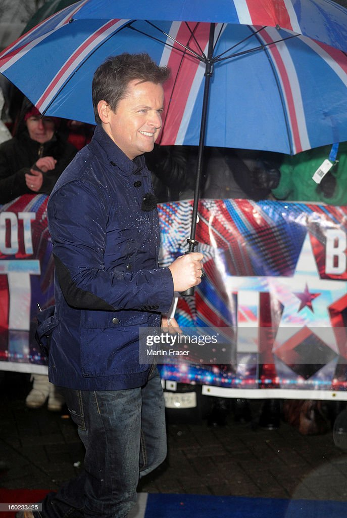 Declan Donnelly arrives under a Union Jack umbrella at the very wet Glasgow auditions for Britain's Got Talent, at Clyde Theatre on January 28, 2013 in Glasgow, Scotland.