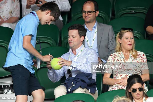 Declan Donnelly giving an autograph and Ali Astall attend day seven of the Wimbledon Tennis Championships at the All England Lawn Tennis and Croquet...