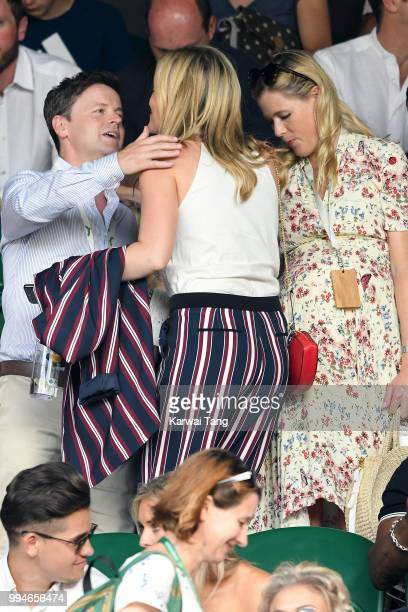 Declan Donnelly greets Laura Whitmore next to his wife Ali Astall as they attend day seven of the Wimbledon Tennis Championships at the All England...