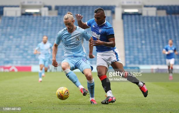 Declan Drysdale of Coventry City vies with Alfredo Morelos of Rangers during the pre season friendly match between Rangers and Coventry City at Ibrox...