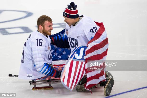 Declan FARMER and Jen LEE react after team USA won the gold medal during The Ice Hockey gold medal game between Canada and United States during day...