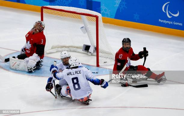 Declan Farmer of the United States celebrates a scored goal in the Ice Hockey gold medal game between United States and Canada during day nine of the...