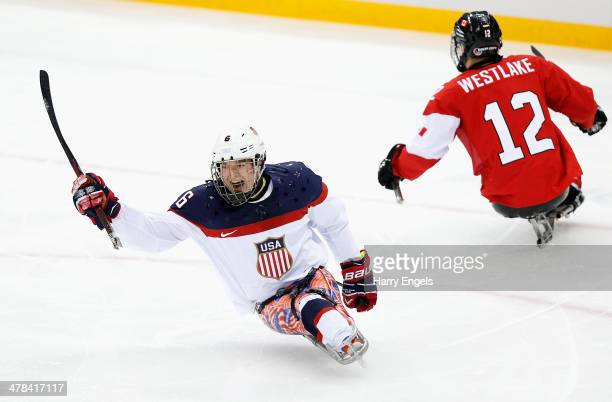 Declan Farmer of USA celebrates scoring his team's first goal during the Ice Sledge Hockey semifinal match between Canada and USA at Shayba Arena...