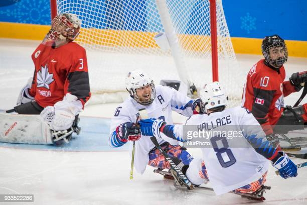 Declan FARMER reacts with Jack WALLACE after scoring the goal that permitted to win the games during The Ice Hockey gold medal game between Canada...