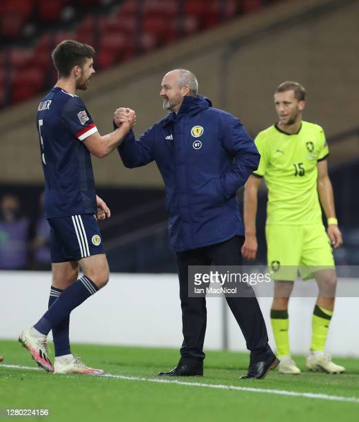 Declan Gallagher of Scotland interacts with Steve Clarke Head Coach of Scotland after the UEFA Nations League group stage match between Scotland and...