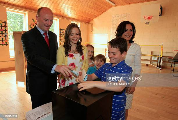 Declan Ganley head of the Libertas party votes with his wife Delia and his children Rafaella Clementine James and Michael at Brierfield National...