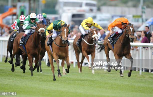 Declan McDonogh on Subtle Shimmer wins from K Latham on Romeo's on Fire in the Paul McGee Memorial Handicap at Curragh Racecourse Co Kildare Ireland